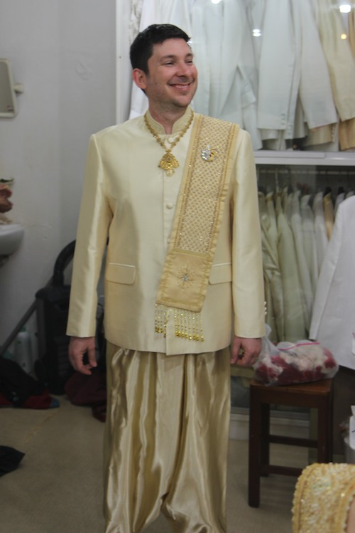Jason tries on wedding suit in Lampang