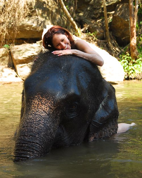 April and her elephant at Patara Elephant Camp, Chiang Mai, Thailand
