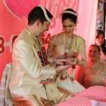 Exchanging rings at our traditional Thai wedding