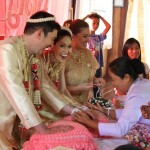 String tying ceremony at our Thai wedding