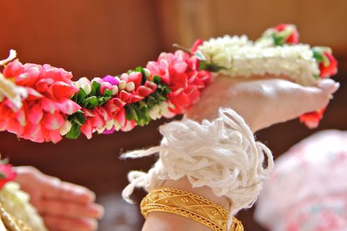 strings on wrist at traditional Thai wedding ceremony