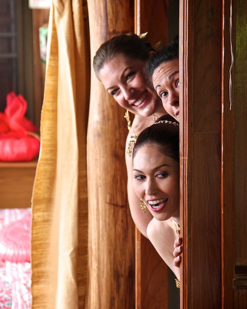 Girls peeking out at Thai wedding ceremony of Wedding World Tour