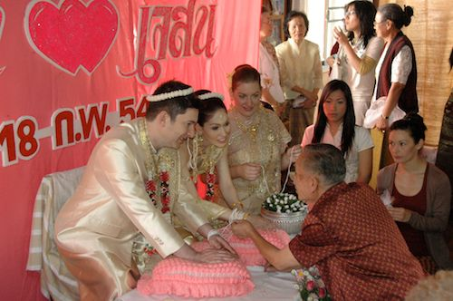 String tying ceremony at Thai wedding of our Wedding World Tour