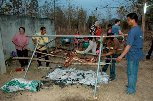 Roasting a pig at the Thai reception of our Wedding World Tour