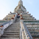 Climbing the stupa of temple in Bangkok, Thailand