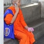 Monk on cell phone in Bangkok, Thailand